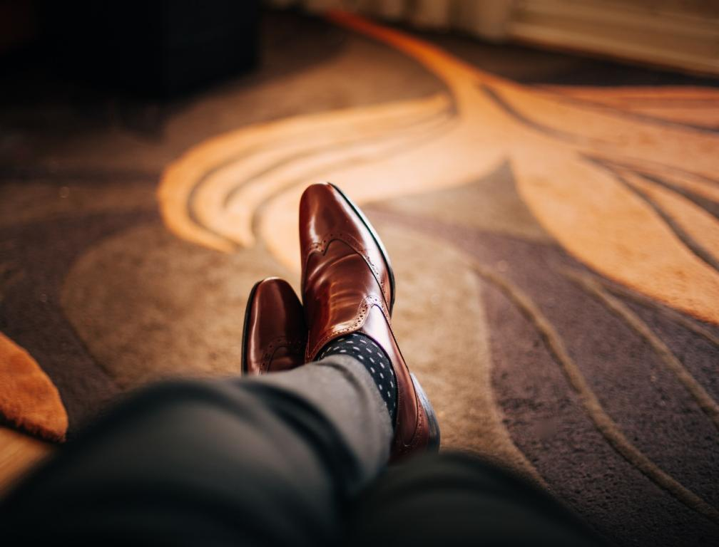 Man with smart shoes with feet up