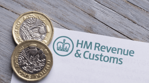 HMRC tax document and pound coins